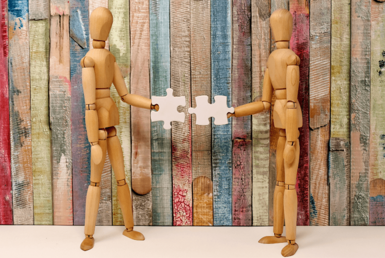 two wooden people interlocking puzzles