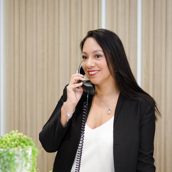 karina-answering-phone-black-suite-white-blouse