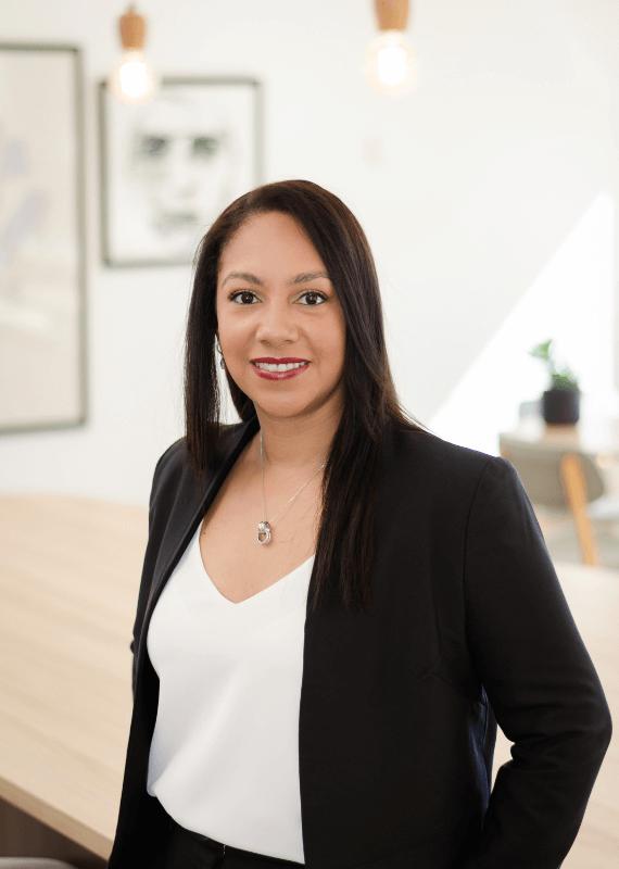 Karina-digital-marketing-strategy-expert-looking-straight-black-suit-white-blouse